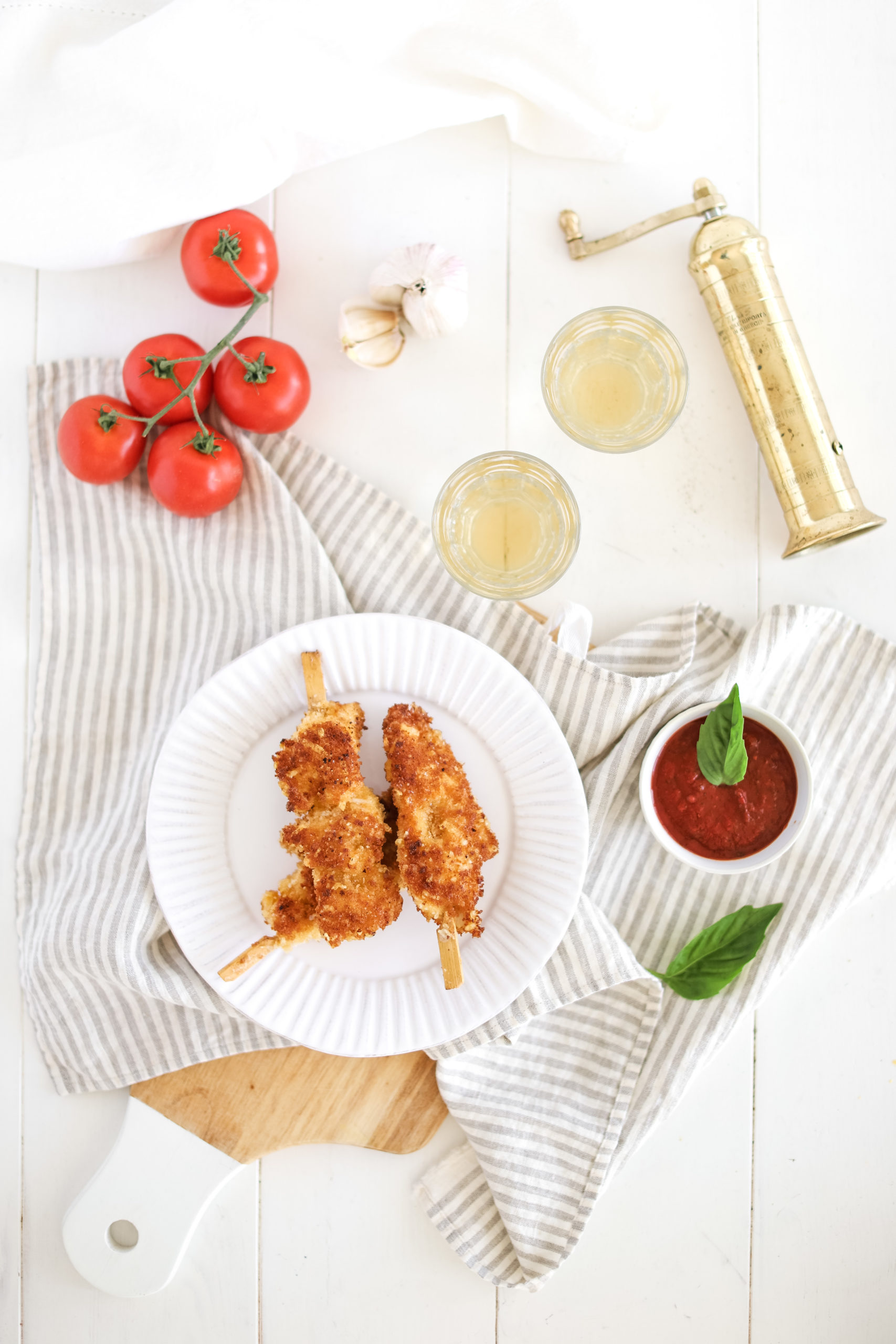 chicken parmesan pops on a plate with tomato sauce