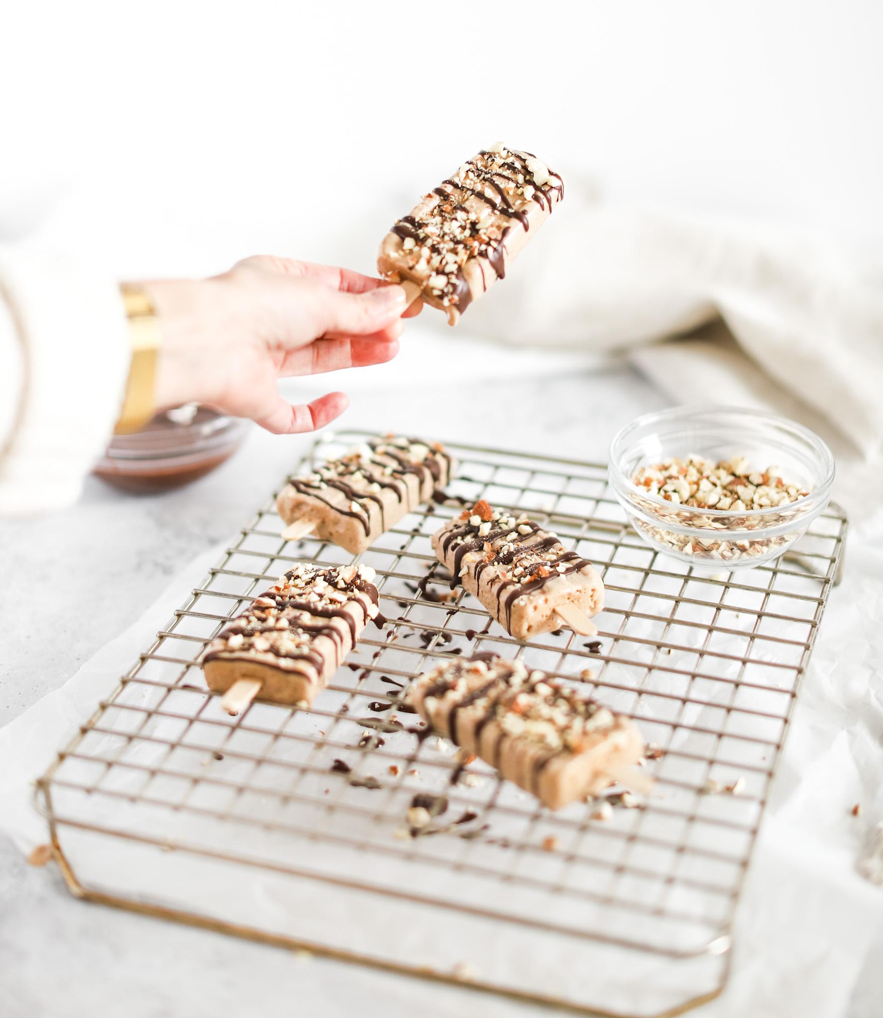 hand grabbing an almond roca vegan popsicle