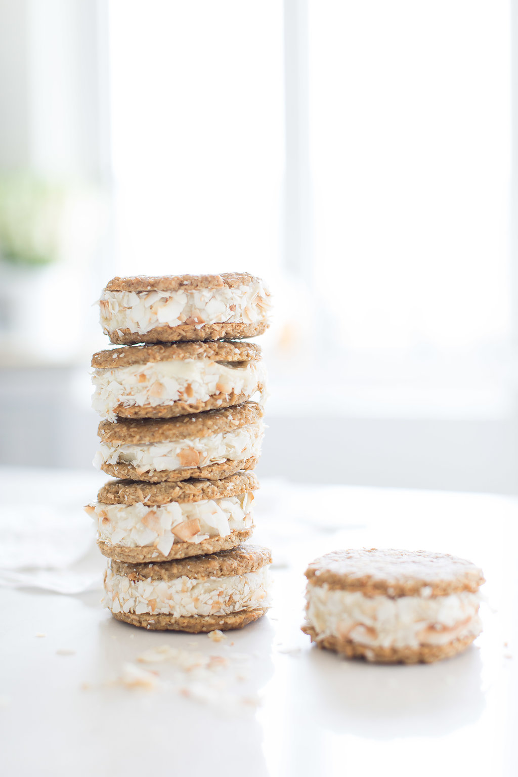 Tropical Nice Cream (vegan) sandwiches using Almond Breeze almond beverage, rolled in toasted flaked coconut and perfect for a healthy summer treat!