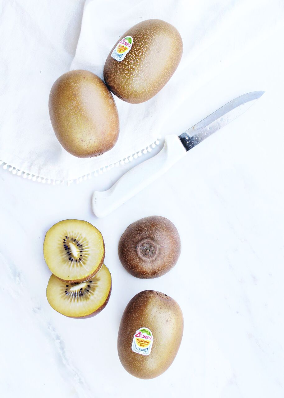 Kiwis on white linen