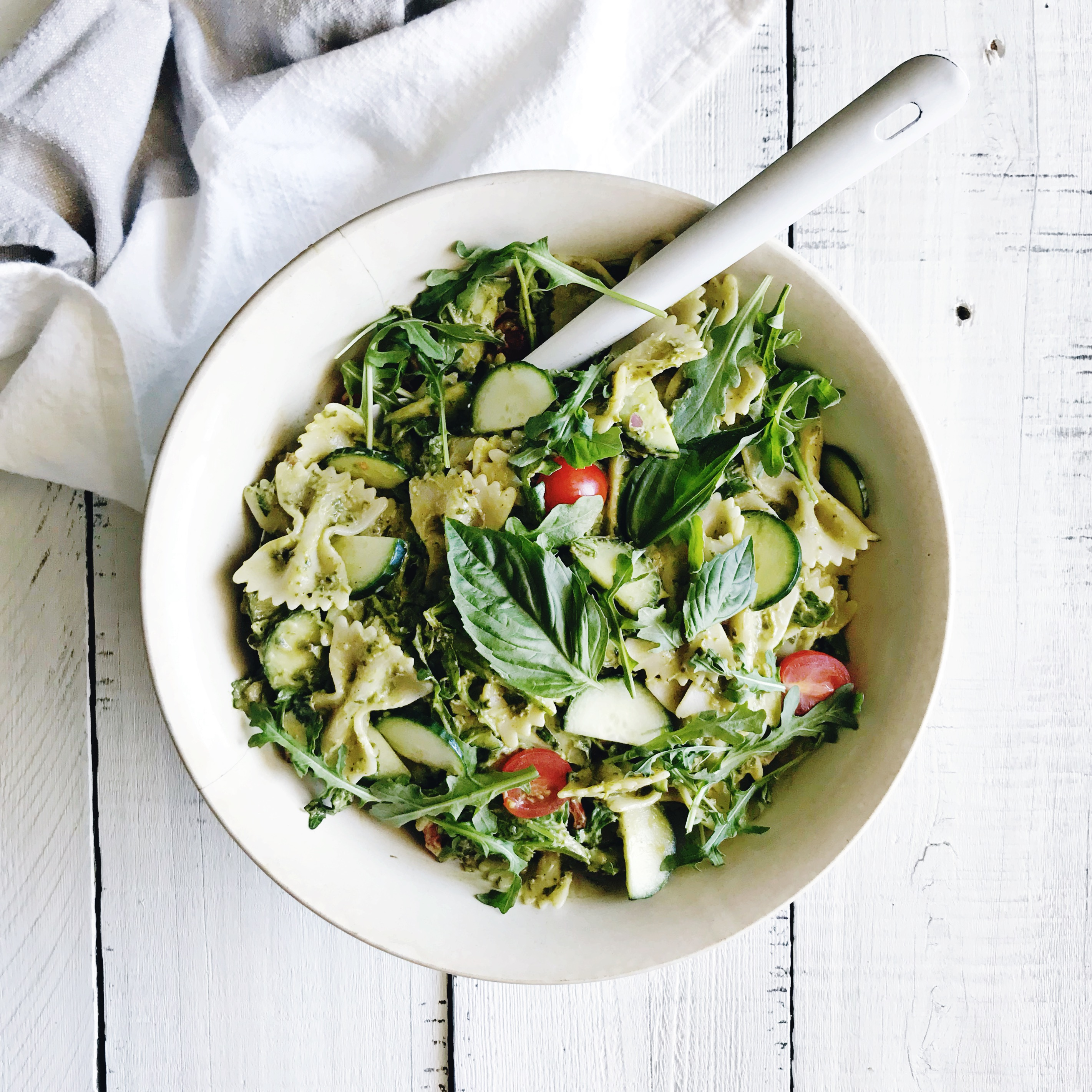 Creamy Avocado Pesto Pasta Salad with a vegan and nut free option!