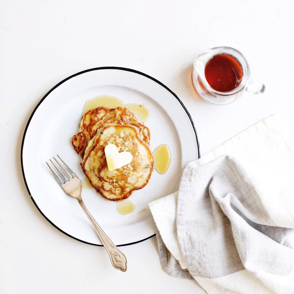 Zucchini Bread Pancakes with a heart-shaped butter