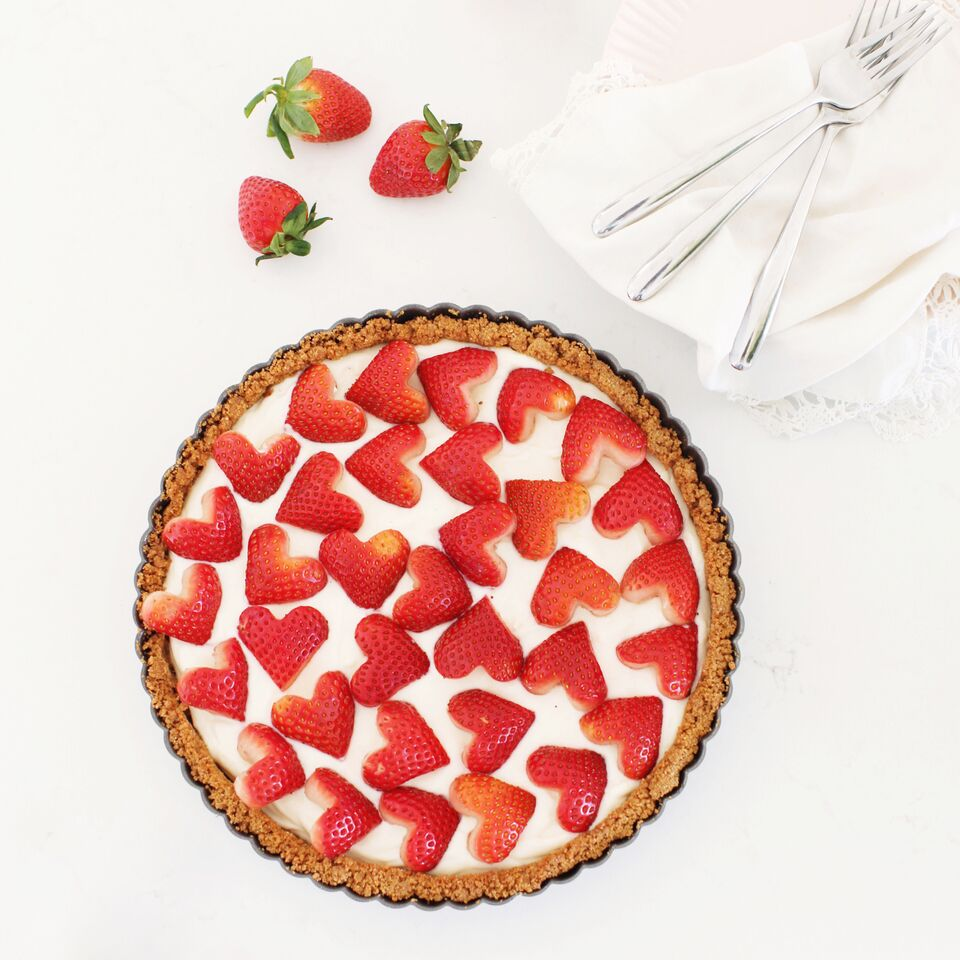 Strawberry & Cream Sweet-tart made with yogurt and topped with heart-shaped strawberries - perfect for Valentine's Day dessert !