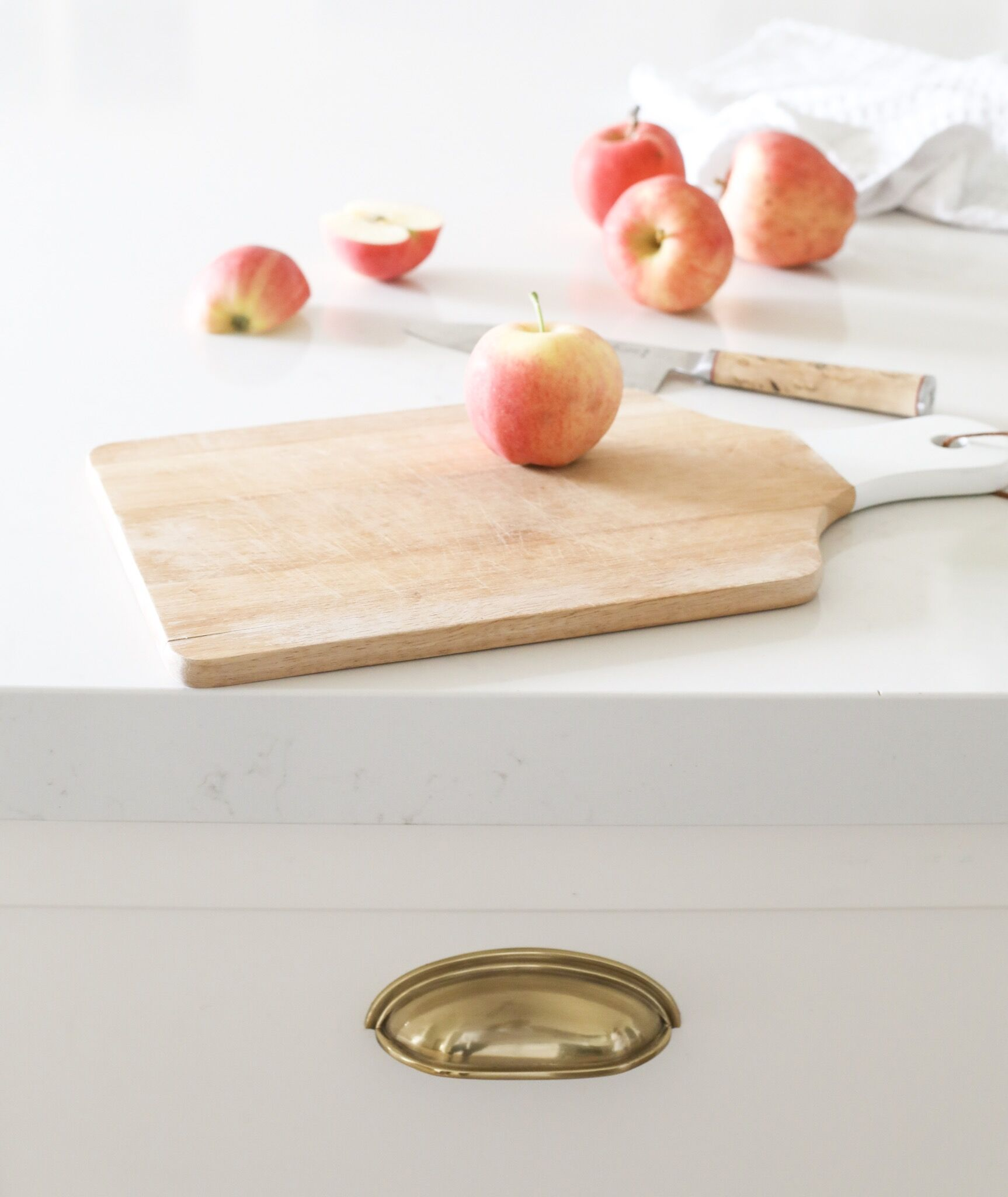 Fraiche Nutrition White Kitchen Reveal: brass antique French cup hardware and Silestone counter with Statuario