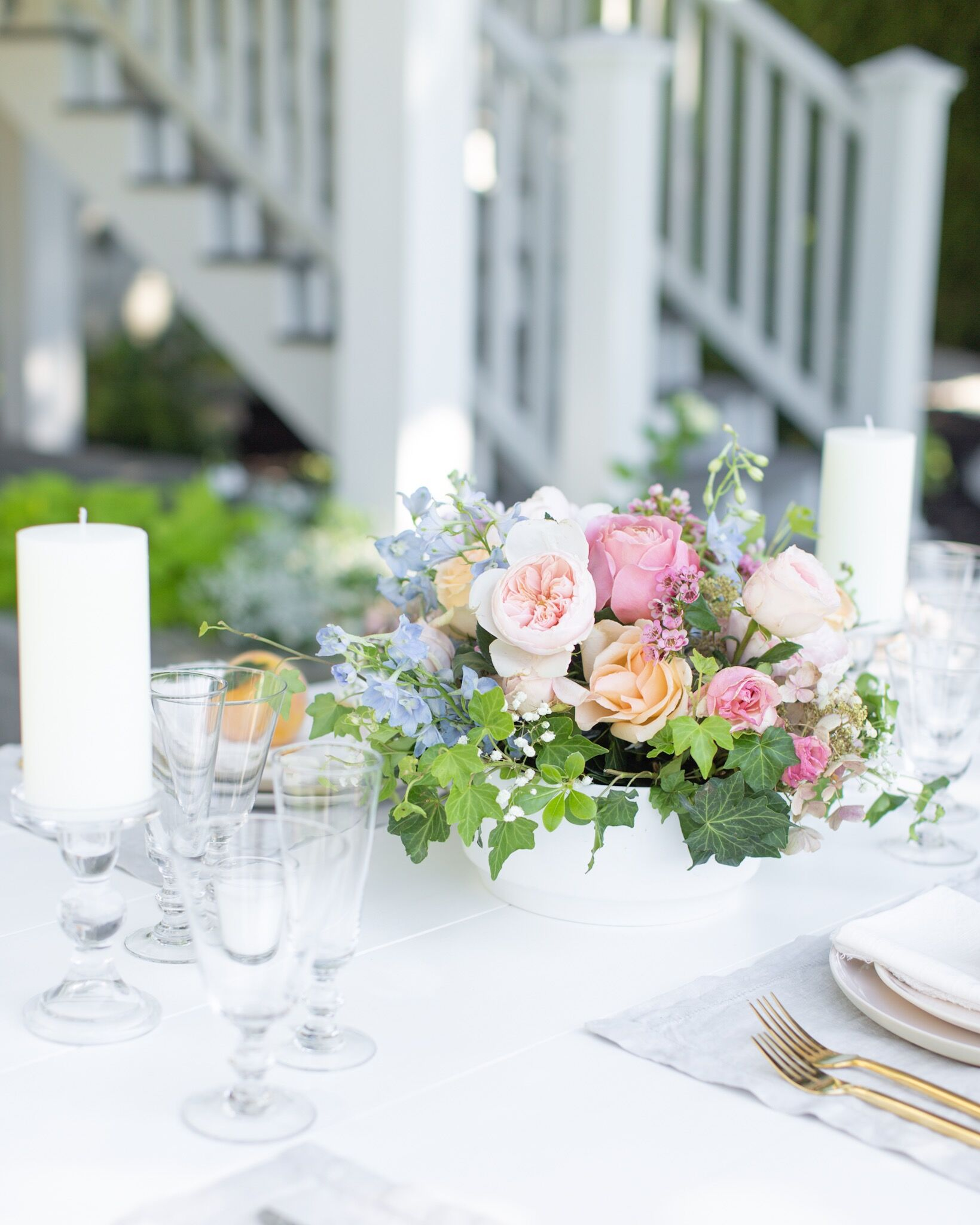 How to throw the best garden party complete with a white picnic table, a wine-paired menu, fresh flowers and a hostess schedule