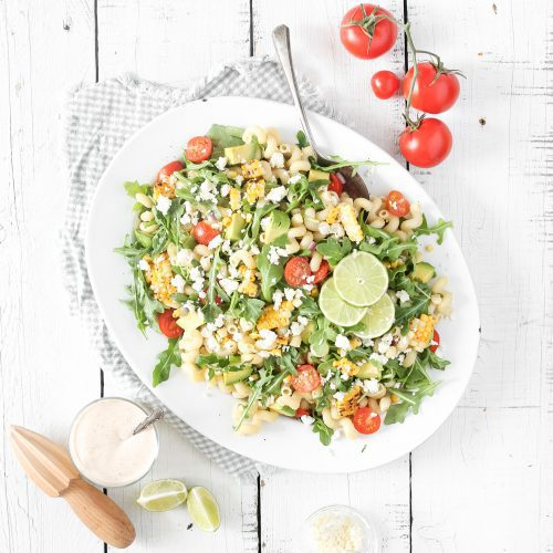 Fraiche Living Grilled Corn Pasta Salad in a bowl with lime